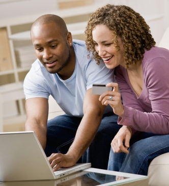 Couple using credit card to shop online conveniently